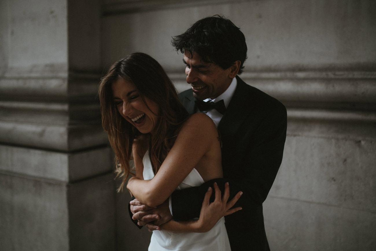 bride and groom laughing together in london