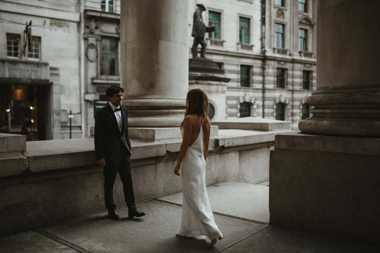 bride and groom at london royal exchange building