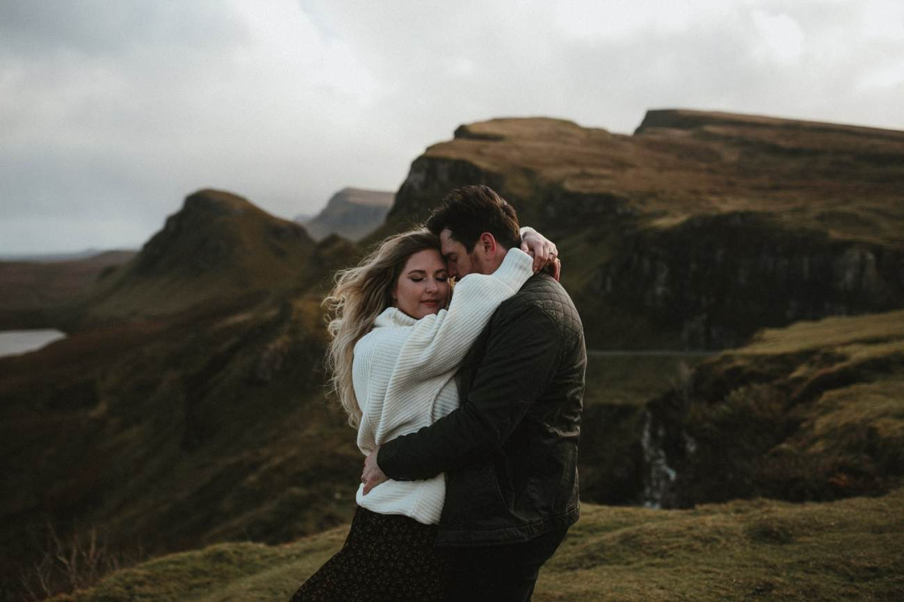 Couple hugging at The Quiraing during adventurous anniverary session in Isle of Skye