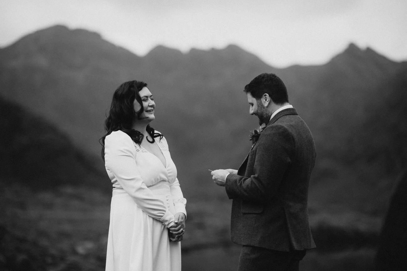 Groom reading vows during wedding at Loch Coruisk