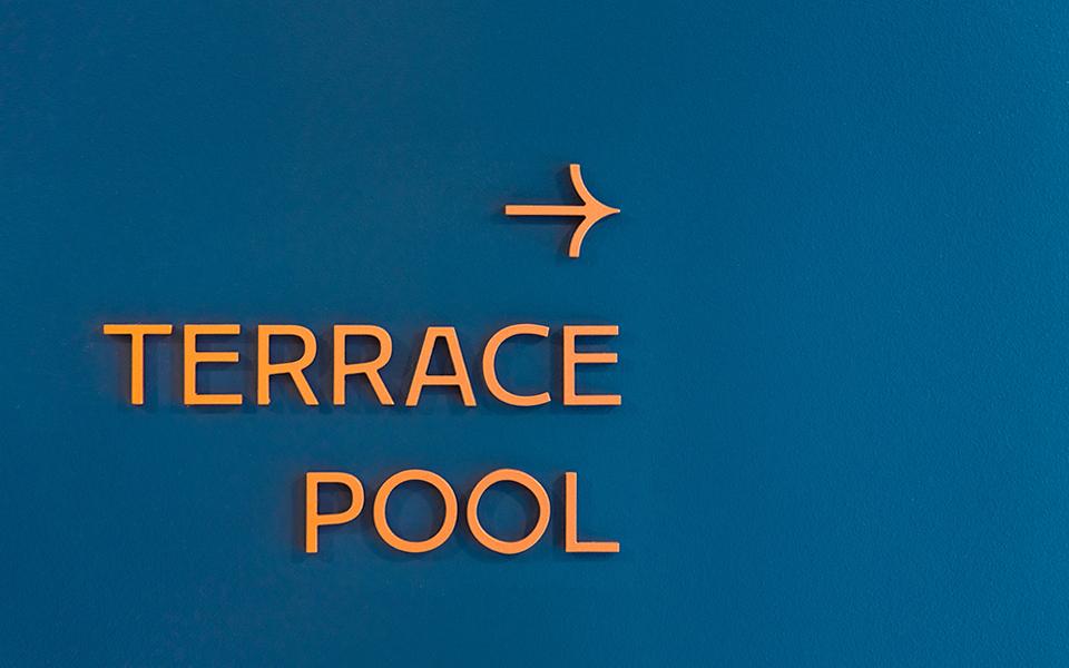 Estate_Terrace-Pool-Signage-Retouched_960x600
