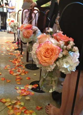 Cabbage roses and hydrangea shepherd's hook aisle markers