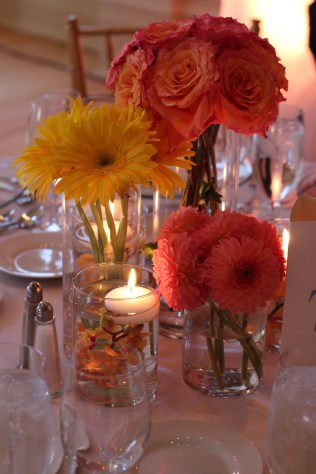 Coral and Yellow Centerpiece of roses, gerbera's and dahlia's