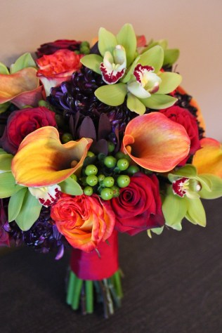 Fall bridal bouquet of calla lilies, orchids, roses, berries and mums
