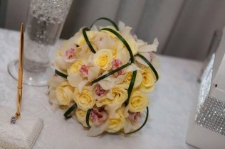 Buttercream rose and white orchid bouquet