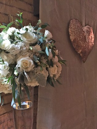 Altar pieces of hydrangea, roses, lisianthis, dusty miller and seeded eucalyptus