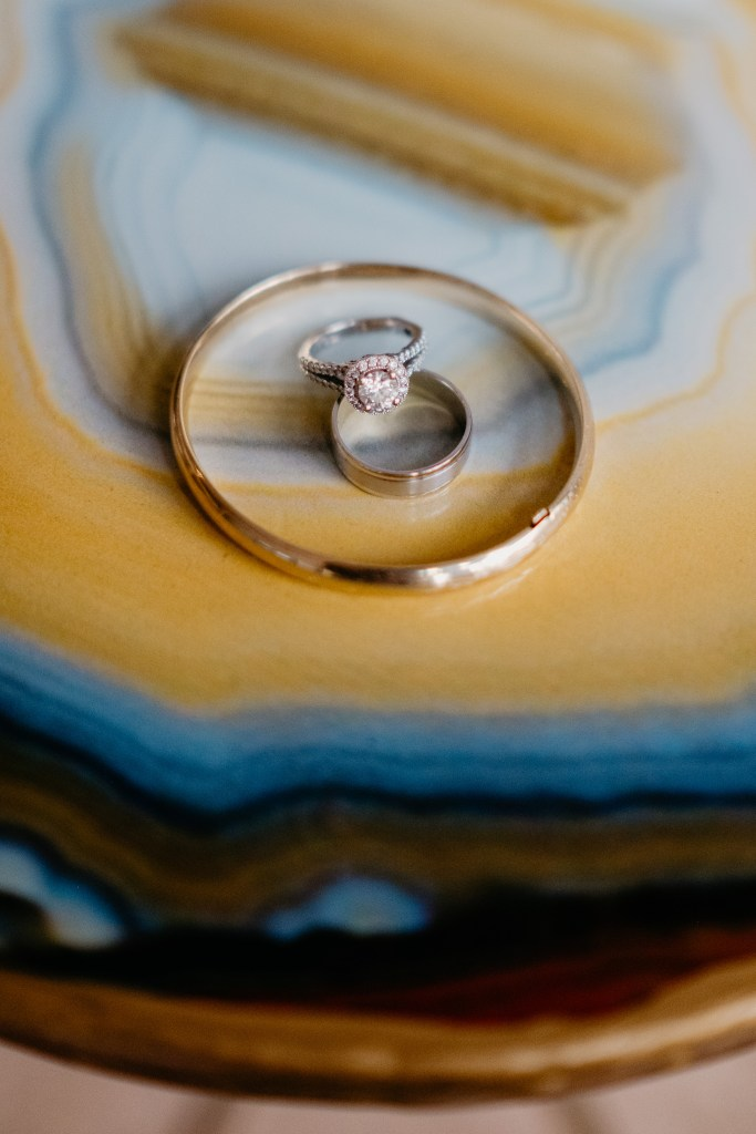Detail of Skyler's heirloom bracelet and wedding ring set atop an agate table.