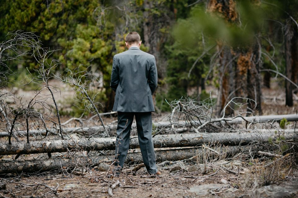 A nervous groom slips into the woods for one last bathroom break before the wedding ceremony.