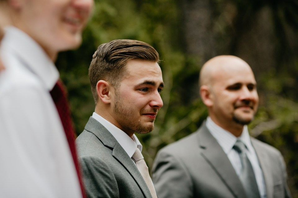 This tear-filled groom stands in awe of his gorgeous bride walking towards him, seeing her for the first time.