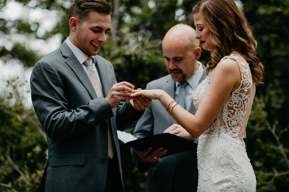 Blayke places the ring on his bride's finger.