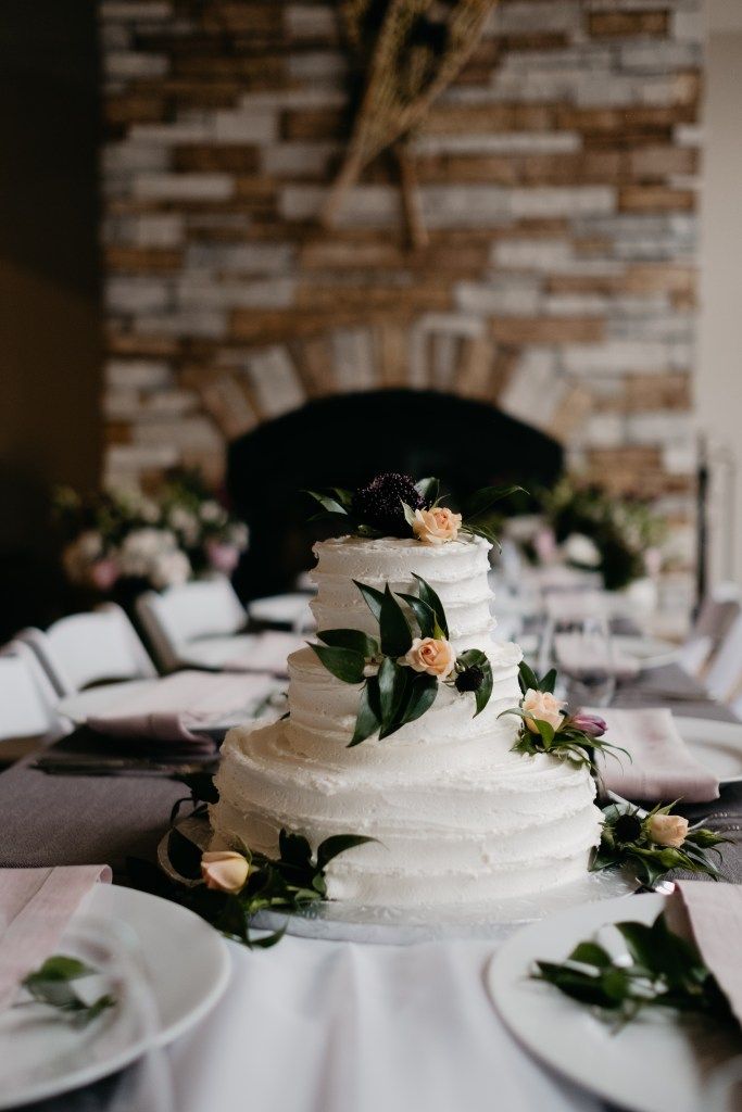 The mother of the bride created a beautiful cake for the couple on their intimate wedding day.