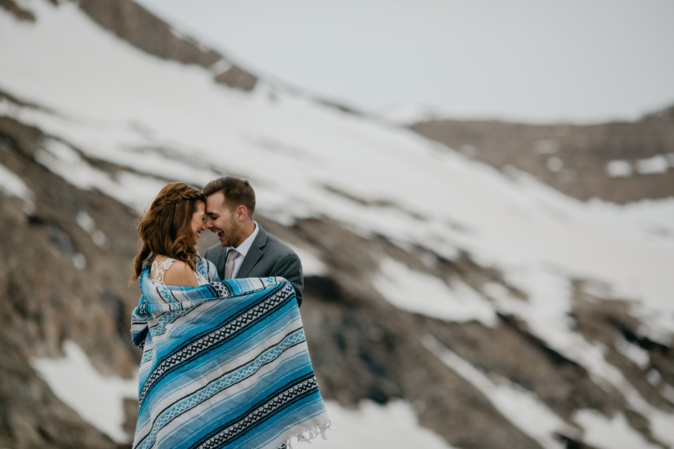 Bride and groom are all smiles and joy during their epic mountain elopement session.