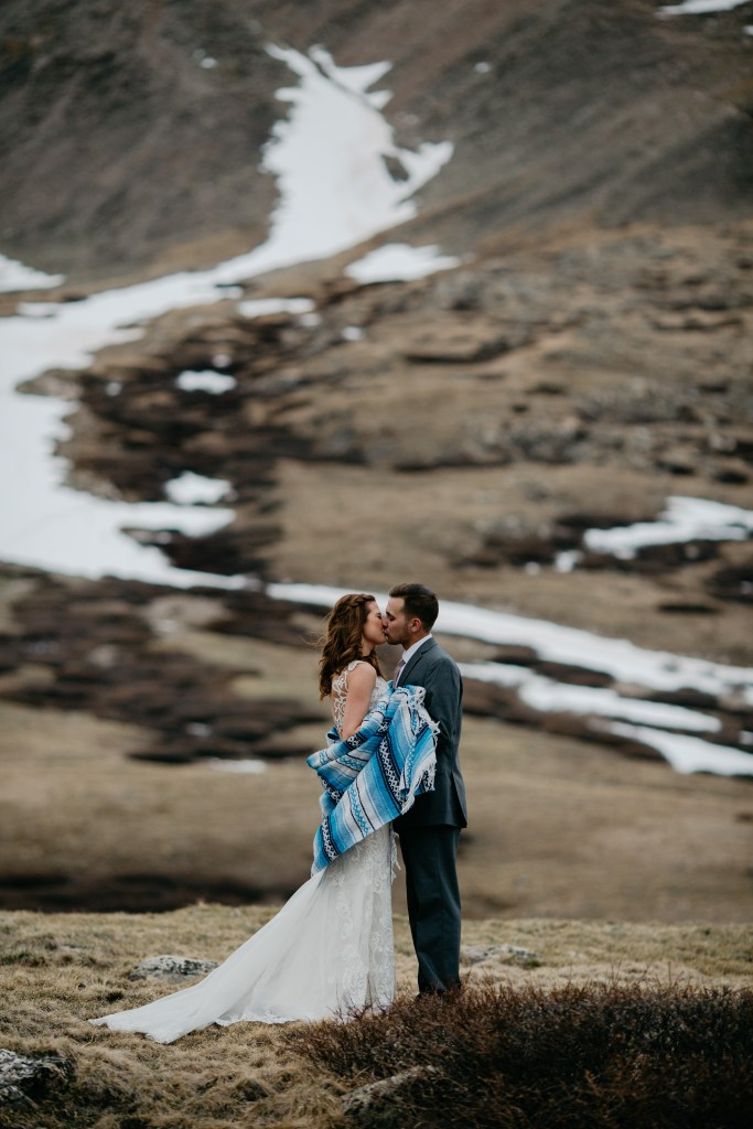 Snow remains afield during this May elopement in Colorado.