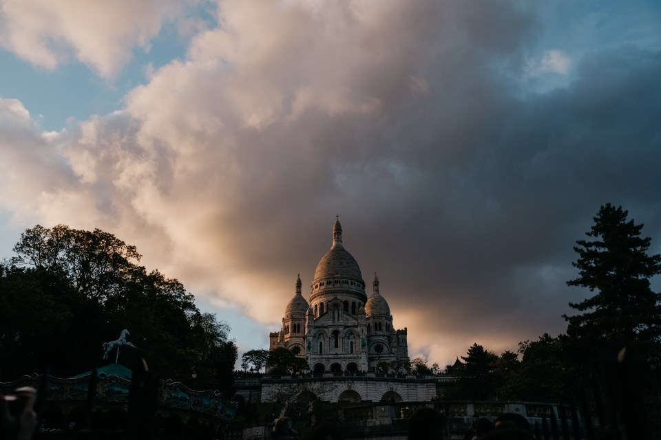 A stormy sunset illuminates the Sacre Coeur in Montmarte, Paris, France.