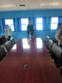 To the right of the soldier is North Korea, to the left is South