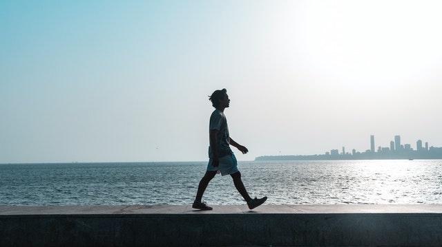 Man walking along the waterfront