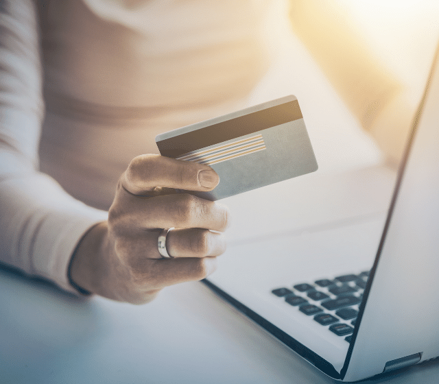 Woman holding creditcard