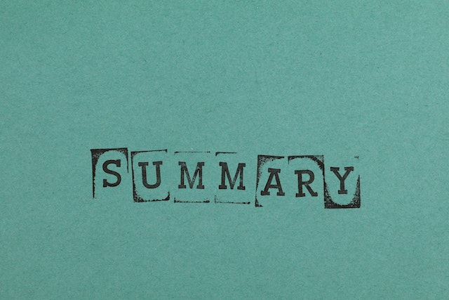 Word summary stamp on green paper