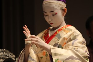 Master of kabuki stands with traditional makeup and clothing.