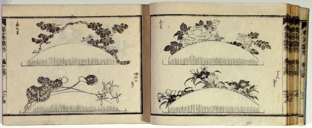 Open book with two horizontal floral design images on each page.