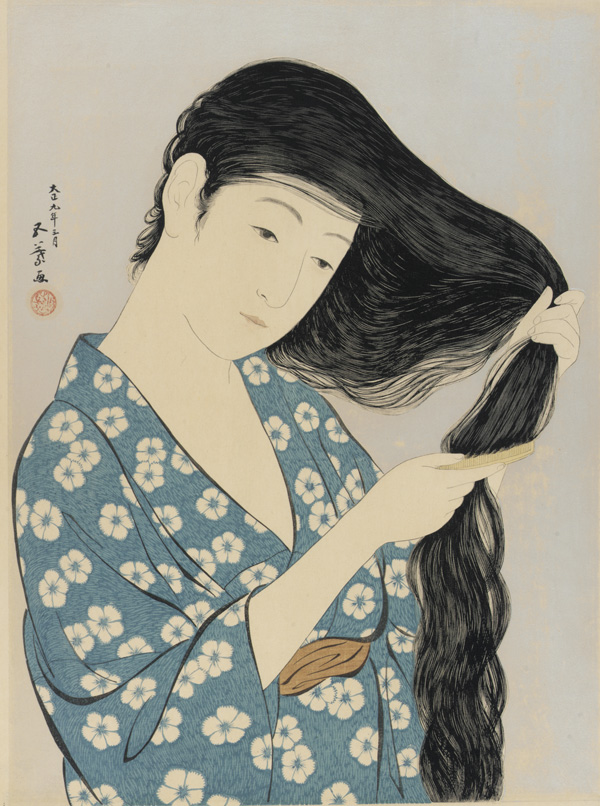 Woodblock print of woman in a blue yukata with white flowers combing long, wavy black hair.