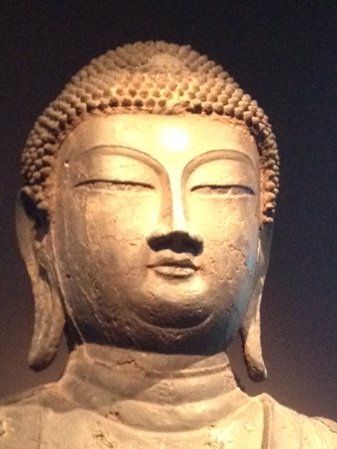 Head and neck of stone Buddha.