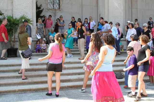Visitors learn to dance on the steps of the Freer