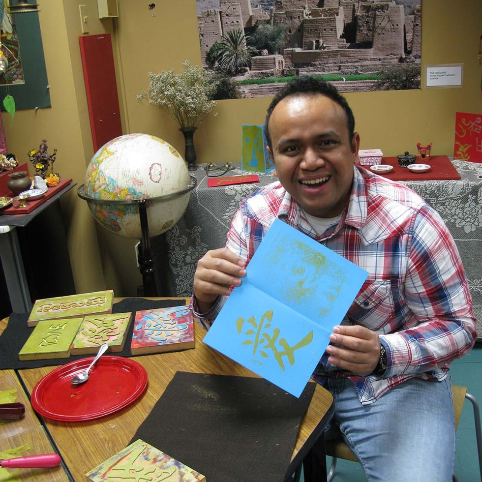 Making a Valentine's Day card in the Imaginasia classroom.