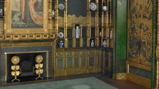 the fireplace of the Peacock room
