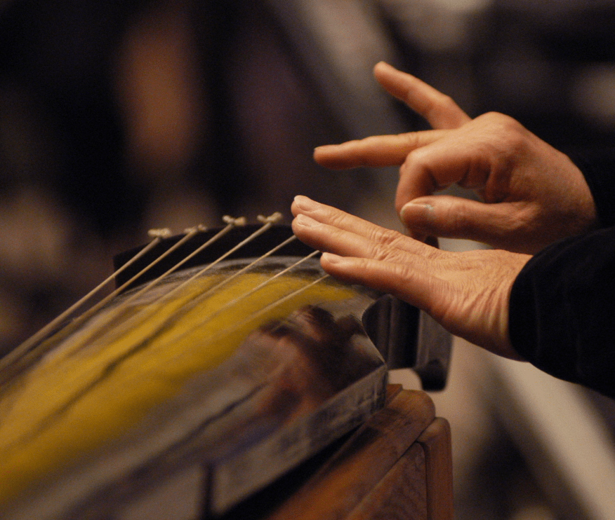 Playing the Chinese qin. Photo courtesy of Bell Yung.
