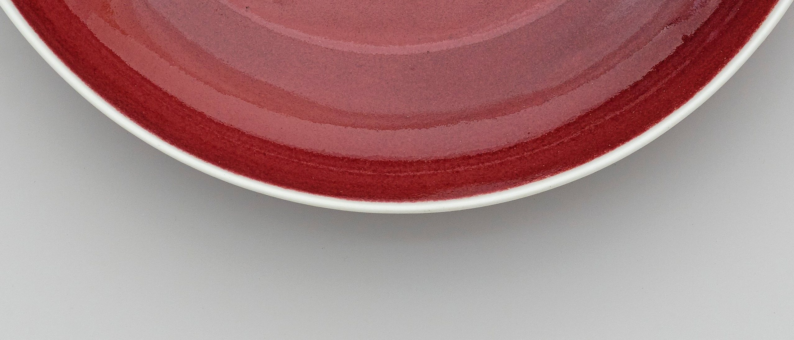 Dish with copper-red glaze, and a Xuande mark in cobalt oxide on the base