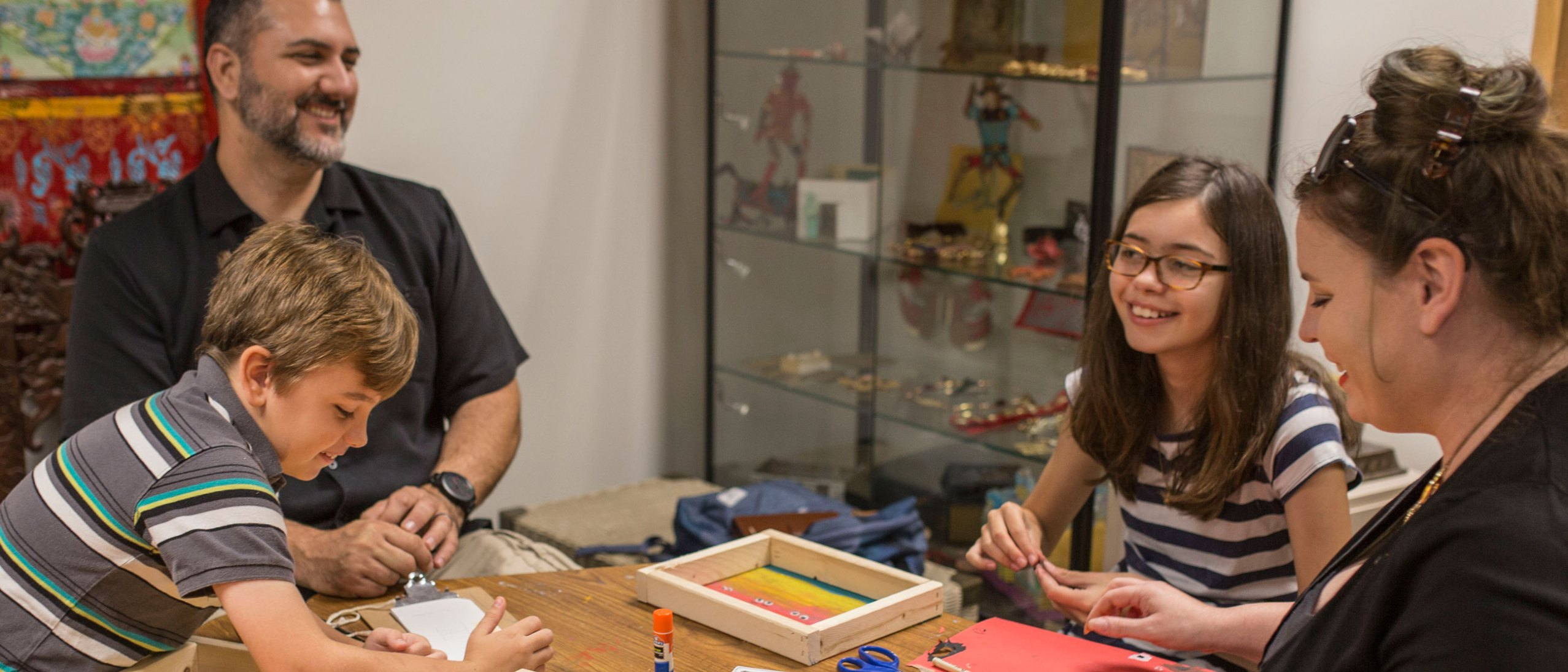 Family enjoys an ImaginAsia art workshop together