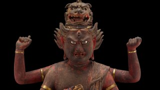 Detail of a sculpture of an intimidating Buddhist diety, Aizenn Myo'o, F1974.21