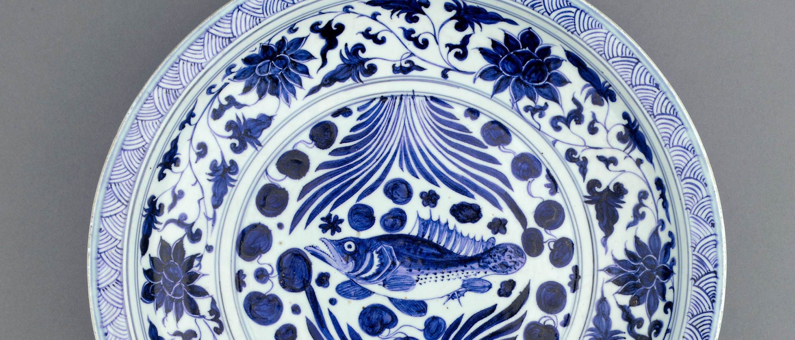 Detail image, Dish with design of mandarin fish; Yuan dynasty, mid 14th century; Porcelain with cobalt pigment under colorless glaze; Freer Gallery of Art, F1971.3