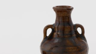 upper half of a brown glazed jug with looped handles