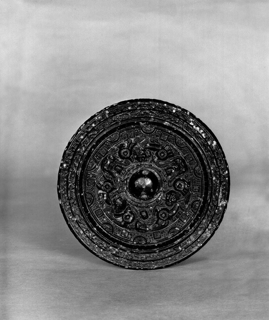 Photo, Bronze mirror. Western Han dynasty, 2nd century BCE., Diam: 10.5 cm. (4 1/8 in.) Singer catalogue number: [1030].