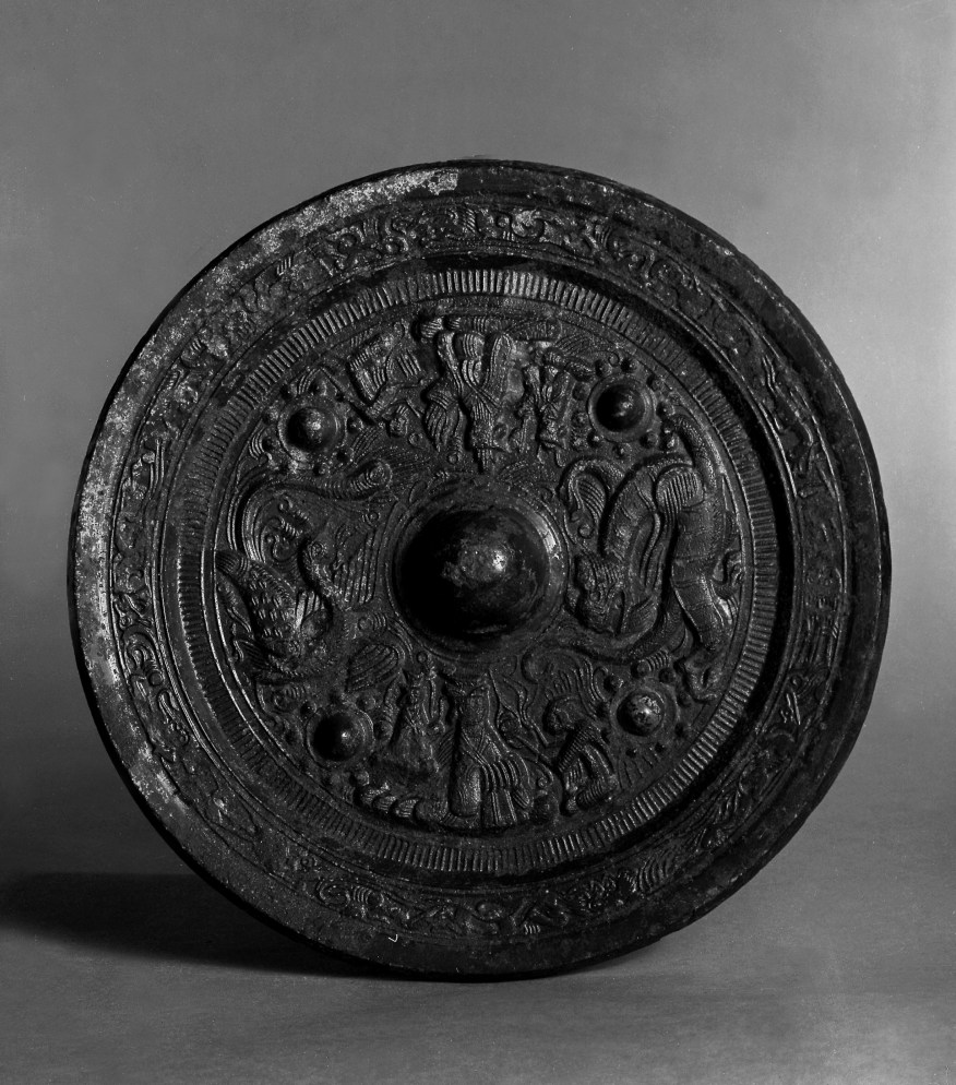 Photo, Bronze mirror. Late Eastern Han dynasty, 2nd–3rd century CE., Diam: 19.9 cm. (7 13/16 in.) Singer catalogue number: [1034].