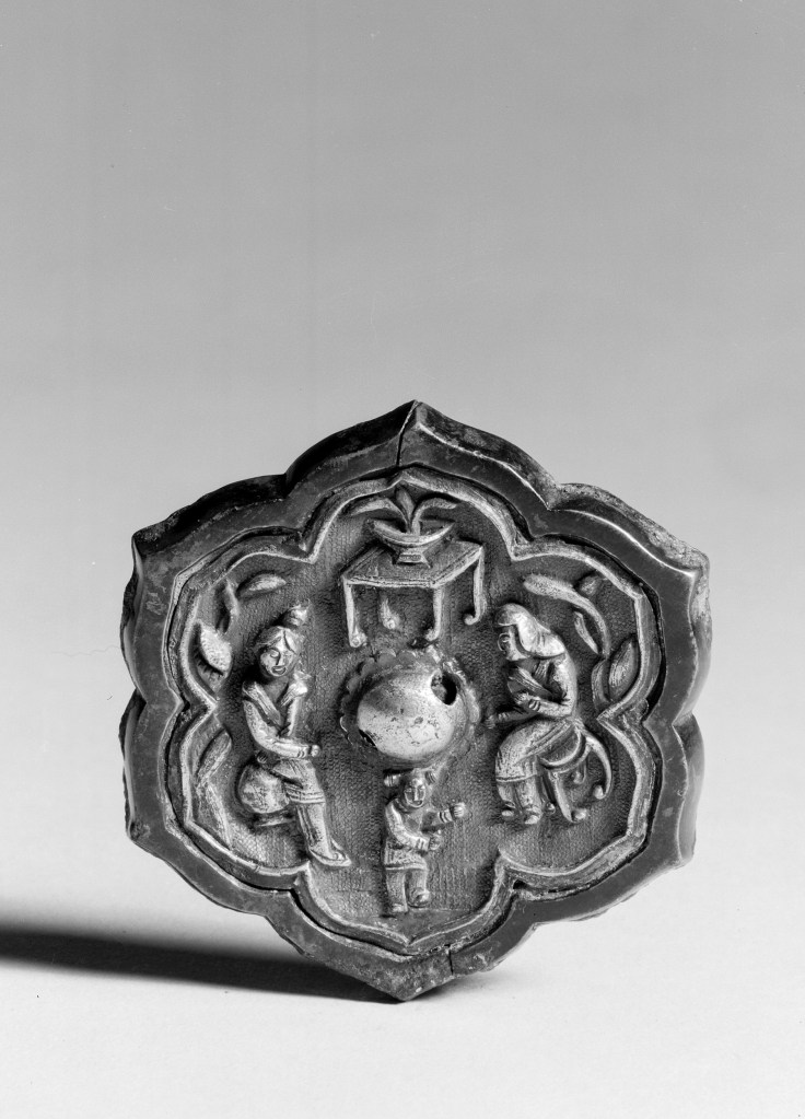 Photo of Bronze mirror with gilt silver back. Tang dynasty, 619–907., Diam: 6 cm. (2 5/16 in.). Singer catalogue number: [1405].