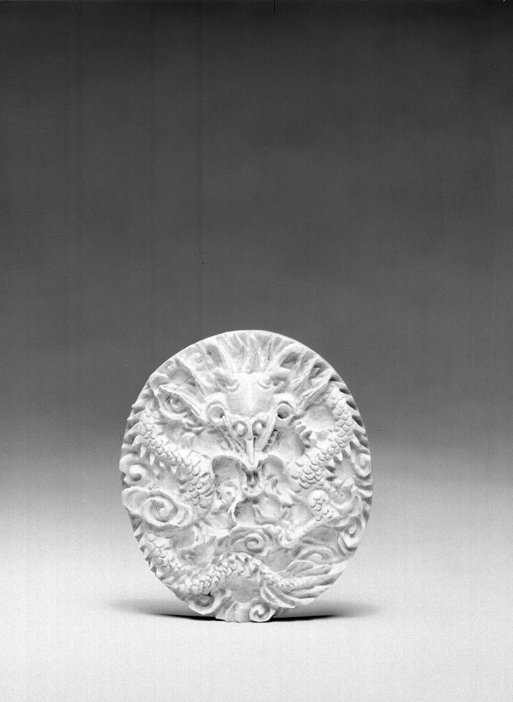 Photo, Ivory dragon plaque. Ming–Qing dynasty, 17th century., H: 6.7 cm. (2 5/8 in.) Singer catalogue number: [1663].