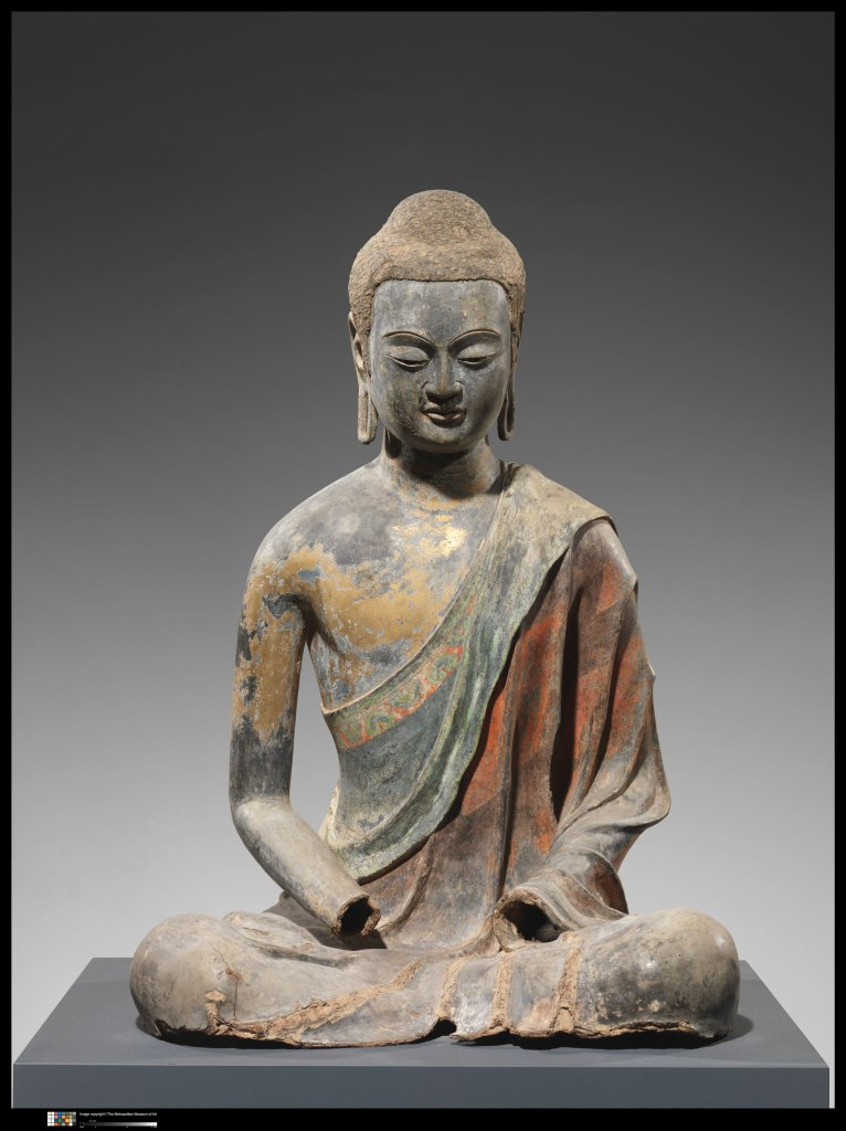 A buddha with traces of pigment showing