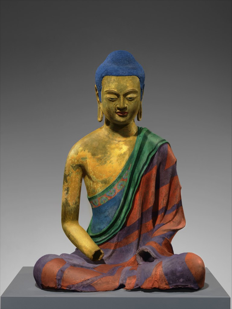 image of a buddha with colors added to speculate on the colors it may have had when it was new