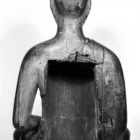 Back of Walters buddha sculpture with a squarish hole in the back