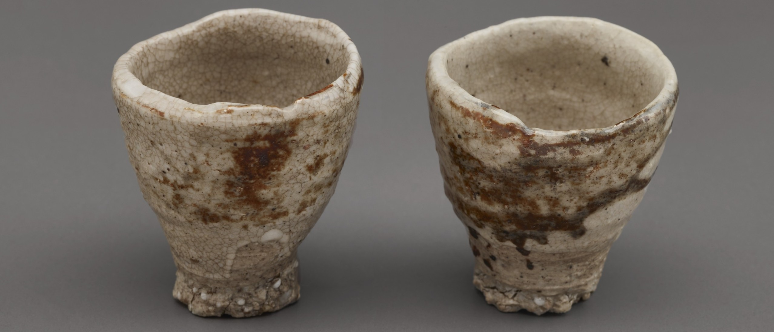 Photo of Two sake cups; Akiyama Yō (b. 1953); Japan, Kyoto, 1992; Porcelain with iron pigment under feldspathic glaze; Gift of Halsey and Alice North; Arthur M. Sackler Gallery S2017.17.1–2