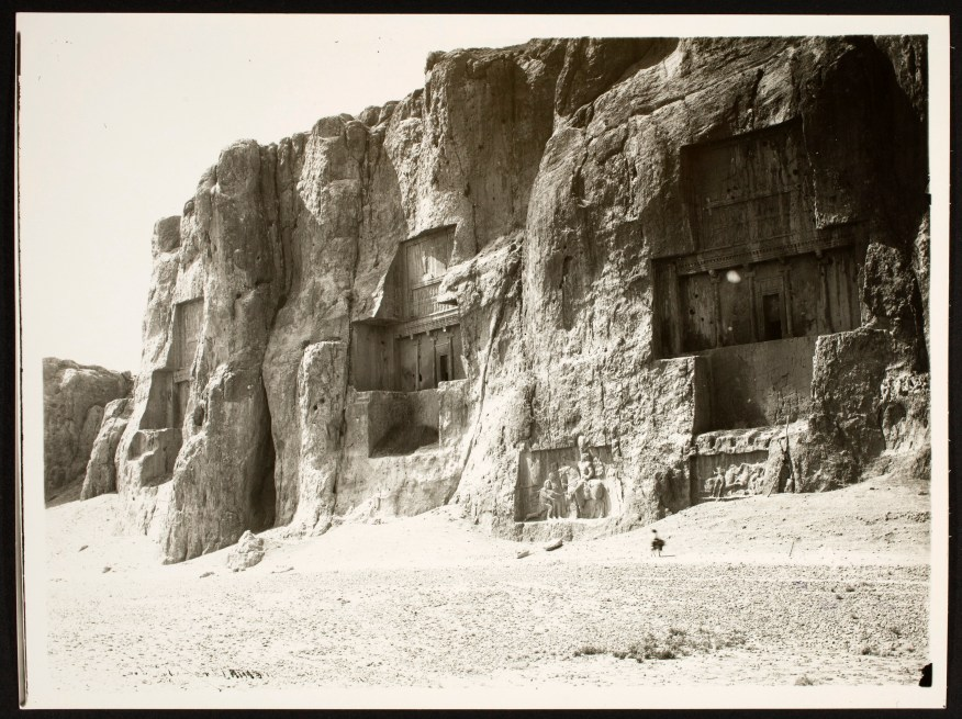 Tomb architecture carved into the face of a cliff.