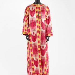 Coat with large red crescents and comb design