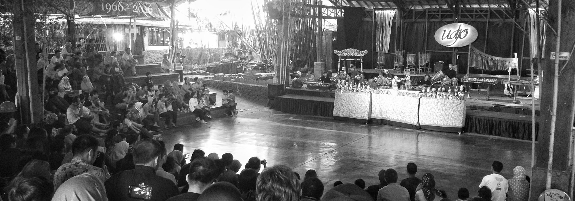 Black and white photo of a crowd watching a performance