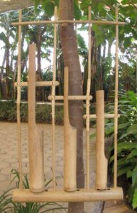 Angklung instrument with three tubes.