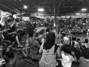 Audience members playing angklung at the Bamboo Afternoon show