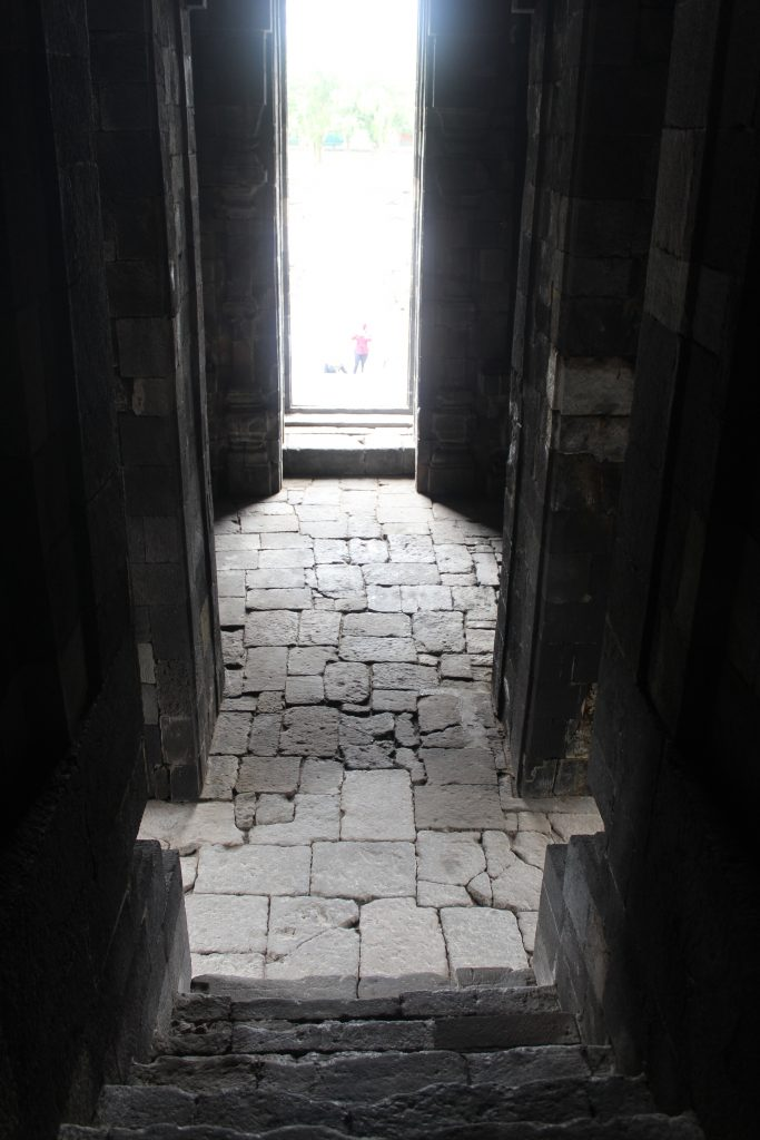 View from dark shrine interior out towards sunlight