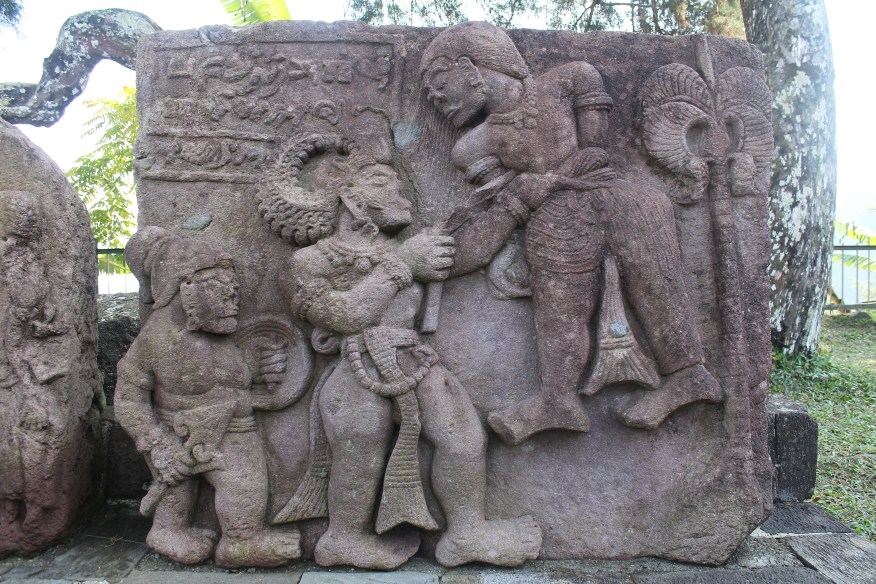 Relief showing two figures fighting